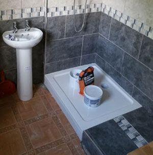 Shower tray raised up on 3x2 timbers