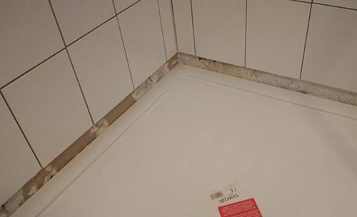 Repaired wall retiled with ceramic tiles