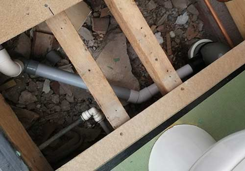 Shower waste connected in to soil pipe