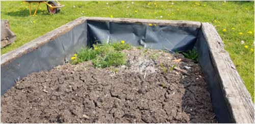Add soil to raised bed