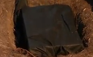 Soakaway crate wrapped in geotextile fabric in soakaway pit