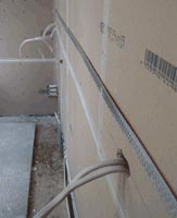 Electrical wires in plasterboard wall