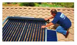 Solar thermal panels being installed on roof