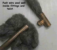 Cleaning copper pipes with wire wool