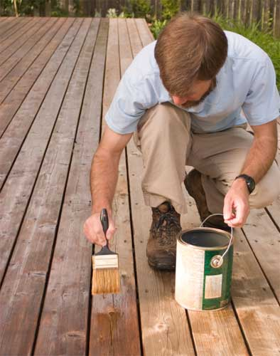 Applying decking stain with a brush