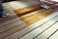 Applying decking stain with pad