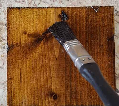 Brushing on top coat varnish