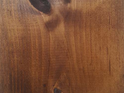 Freshly dyed timber surface