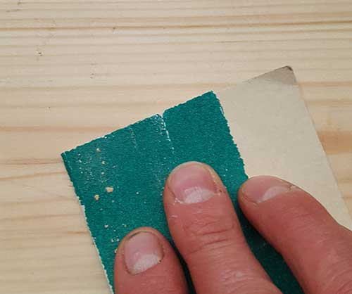 Sanding over timber surface