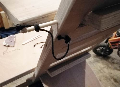 Timber pins secured to main body using lengths of string to prevent them getting lost