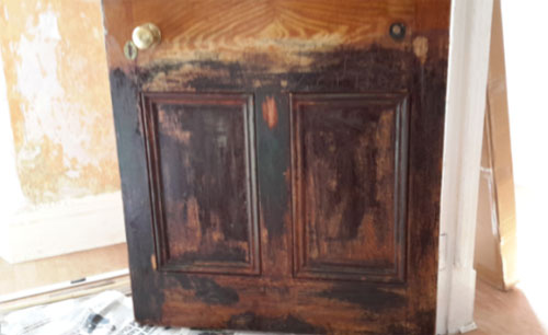 Lead Paint On A Door Being Stripped