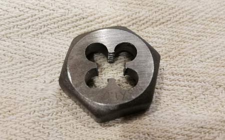 Die used to cut a thread on to a piece of steel or other metal