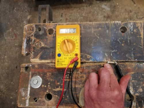 Digital meter showing very little resistance