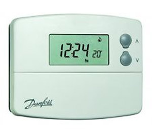 Programmable hard wired room thermostat