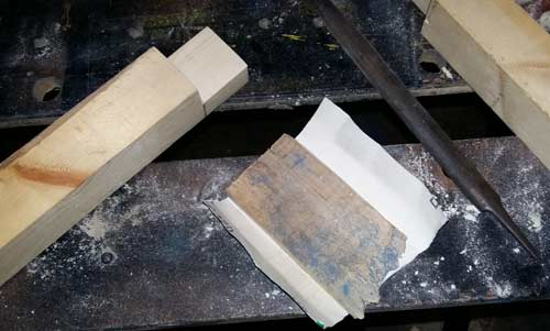 Hand file and sandpaper for cleaning up halved joints