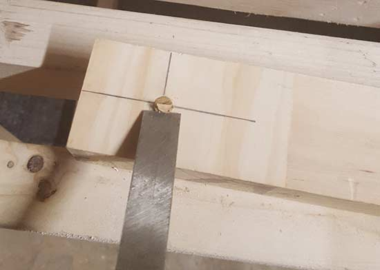 Chisel positioned ready to cut plug