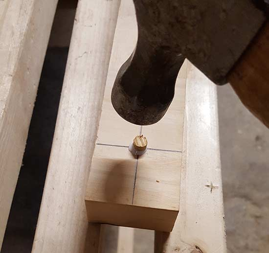 Tapping in timber plug