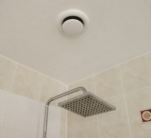 Inline extractor fan installed in zone 1 area above shower