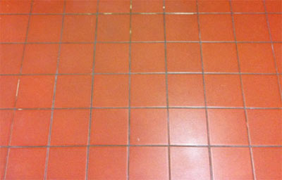 Floor tiled with red quarry tiles