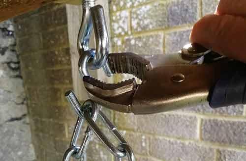 Closing up s-hooks using mole grips