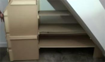 Under stairs cupboard with double hinged doors