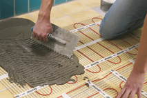 Cover devimat underfloor heating with tile adhesive