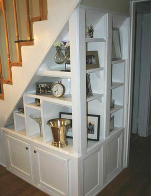 Shelving unit built under the stairs