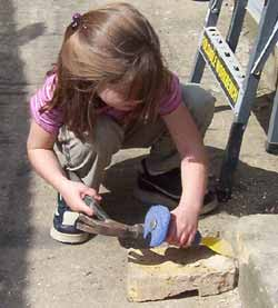 Use a hammer and bloster or chisel to remove mortar deposits from brickwork