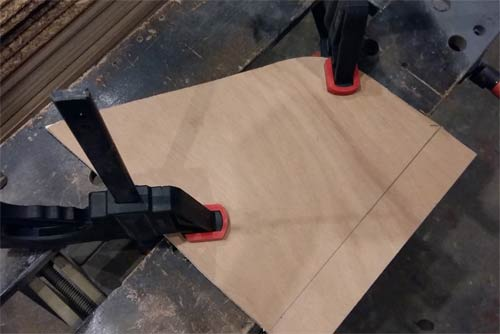 Cutting item fixed firmly to work bench