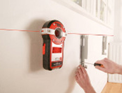 Using a Spot Laser Level to align and level brackets on a wall
