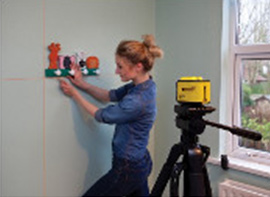 How to use a cross line laser to put pictures or hooks