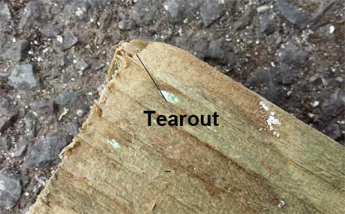 Tearout caused by rasping across timber grains