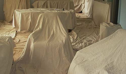 Furniture covered with dust sheets