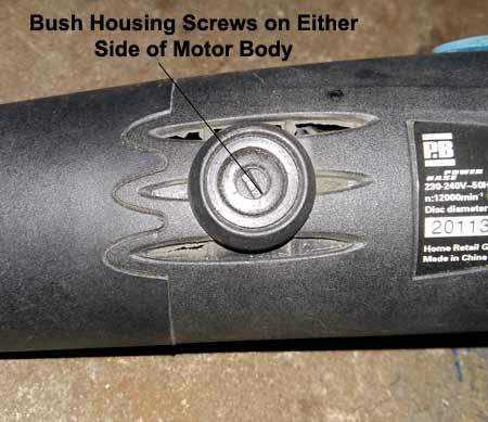 Bush housing screws on side of motor body