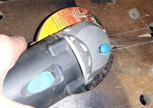 Practicing holding an angle grinder