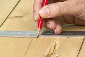 Drill hole marked on timber