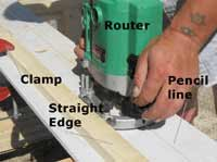 Router setup with clamped straight edge and pencil line to follow