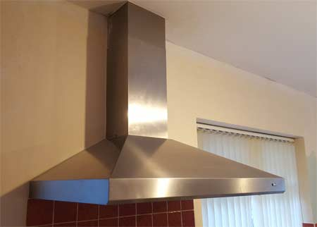 Cooker hood installed above hob