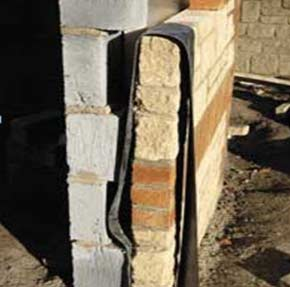 Vertical DPC damp membrane inserted between two walls