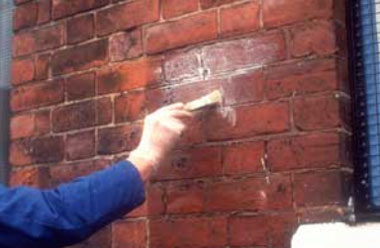 Painting masonry with waterproofer
