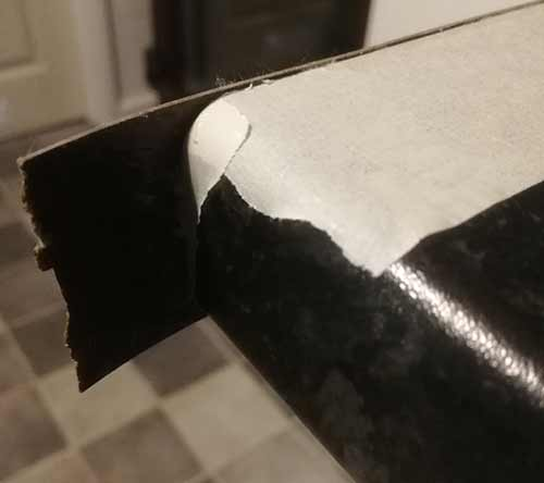 Front edge of laminate strip that needs trimming up