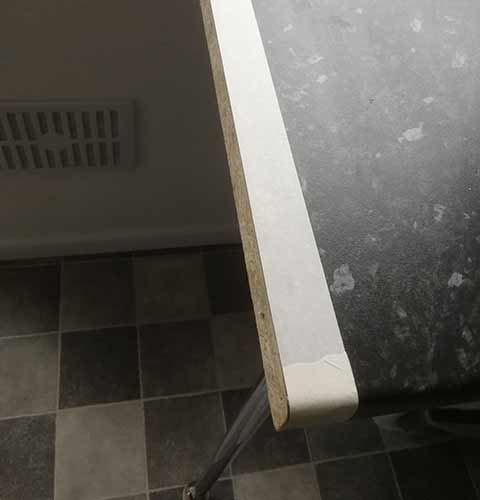 Apply masking tape to the worktop edge