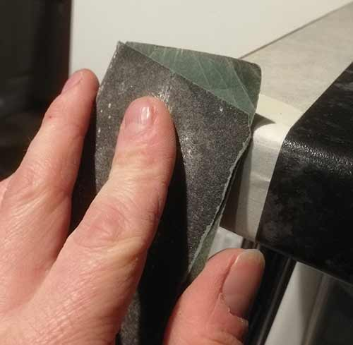 Use sandpaper to fine-tune the shape of your laminate worktop strip