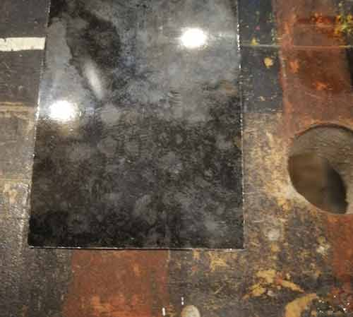 Square off back edge of laminate strip